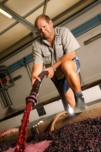 Danie Malan, Allesverloren owner & winemaker performing a pumpover in the cellar