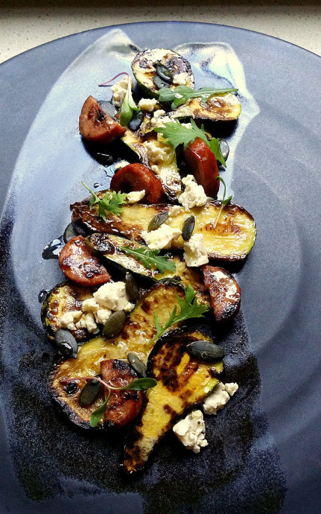 Griddled Baby Butternut with Chorizo, Feta & a Lemon Dressing This beautiful black plate is the work, master potter David Walters of Franschhoek. The shiny black slick of glaze  across the plate is designed to stop your fork from grating.