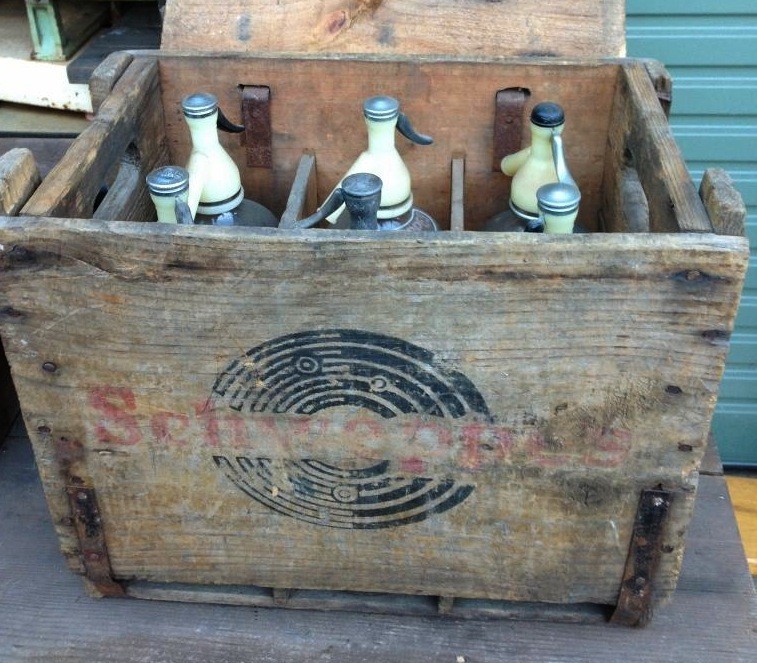 A wooden crate of Schweppes Soda Syphons