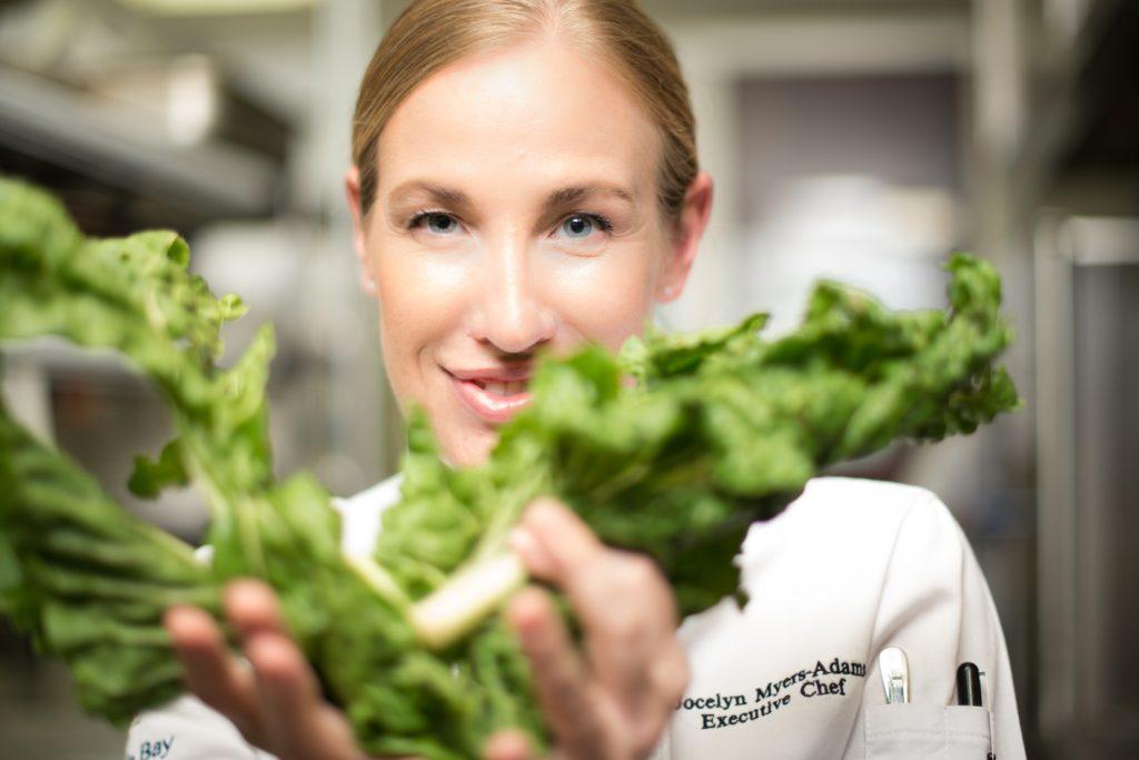 Jocelyn Myers-Adams with greens
