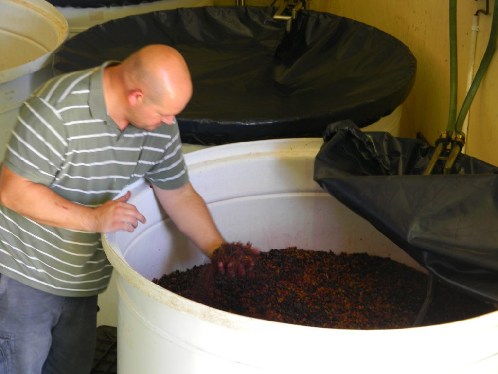 Riaan Moller at one if his open tank fermentation